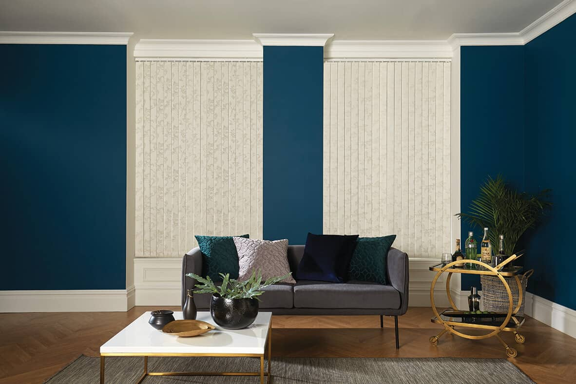 pale patterned vertical blinds in a dark blue living room