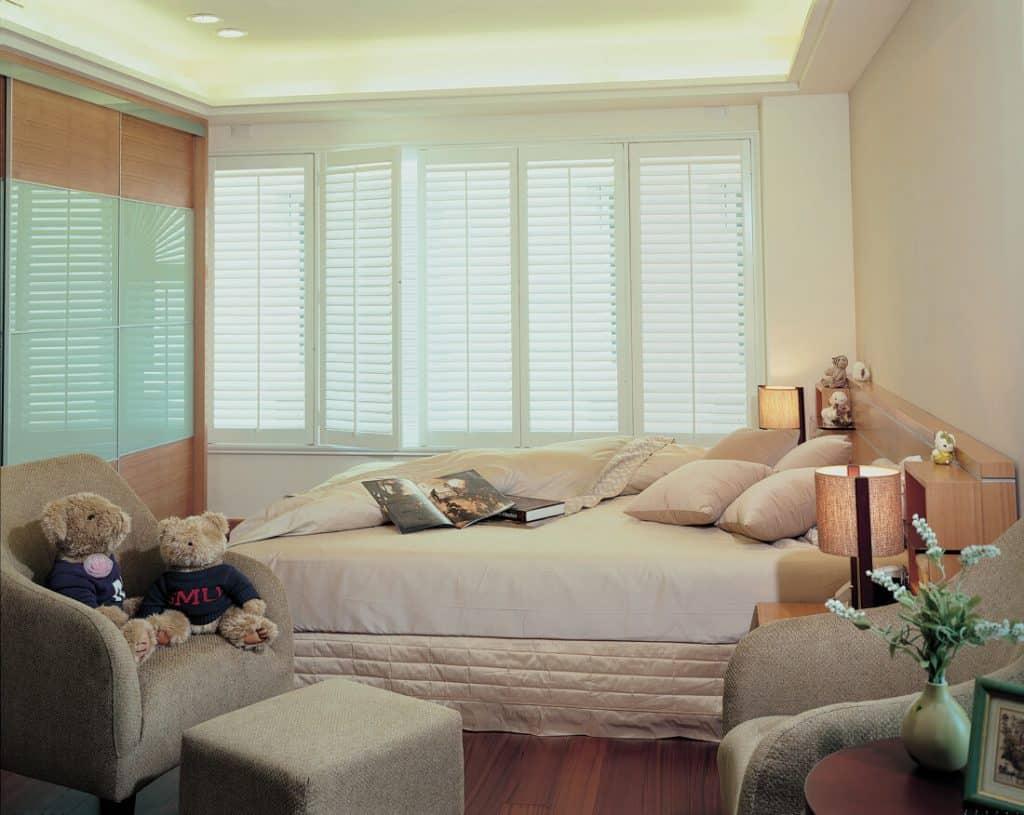 Bedroom white shutter blinds