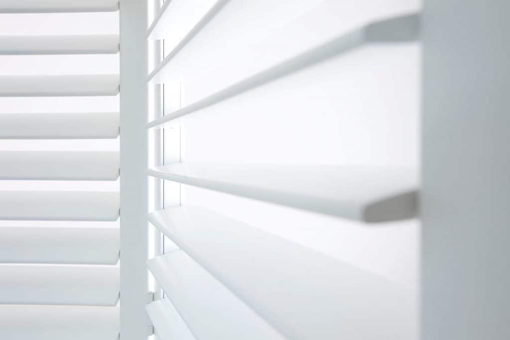 White wooden plantation shutter blinds